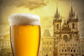 Glass of beer against Tyn Church in Prague - PhotoDune Item for Sale
