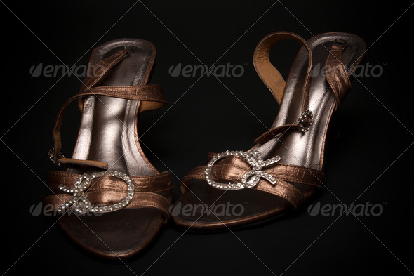 Feminine loafers from golden skin - Stock Photo - Images