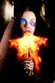 Medieval jester breathing fire during carnival act - PhotoDune Item for Sale