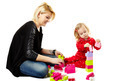 Mother and son playing with colorful cubes sitting on the floor - PhotoDune Item for Sale