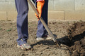 Digging spring soil with shovel. - PhotoDune Item for Sale