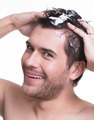Portrait young happy smiling man washing hair. - PhotoDune Item for Sale