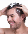 Young happy smiling man washing hair. - PhotoDune Item for Sale