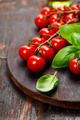 Tomatoes with basil on wooden table background - PhotoDune Item for Sale