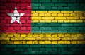 Brick wall with painted flag of Togo - PhotoDune Item for Sale