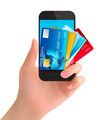 Credit cards in a phone. Internet banking concept.  - PhotoDune Item for Sale