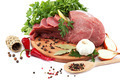 Raw meat, vegetables and spices on a wooden cutting board. - PhotoDune Item for Sale