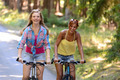 Two teenage girls riding their bikes - PhotoDune Item for Sale
