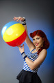 Pin up model in sailor costume holding a beach ball - PhotoDune Item for Sale