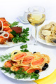 table with food of meat, salmon rolls, dumplings and white wine. - PhotoDune Item for Sale