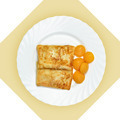 Dish of crepes with dried apricots on white plate. - PhotoDune Item for Sale