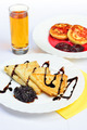food of crepes, cheesecakes with berry sause and glass of juice. - PhotoDune Item for Sale