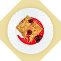 Dish of crepes with cherry sause on white plate. - PhotoDune Item for Sale