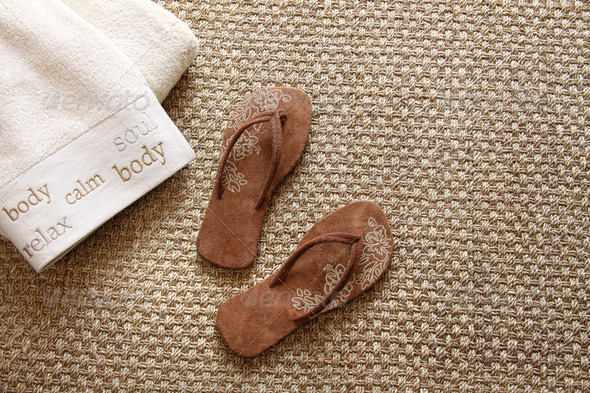 Flip flops with towels on sea grass rug - Stock Photo - Images