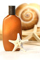 Suntan lotion with seashells - PhotoDune Item for Sale