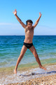 Happy boy jumping on the beach - PhotoDune Item for Sale