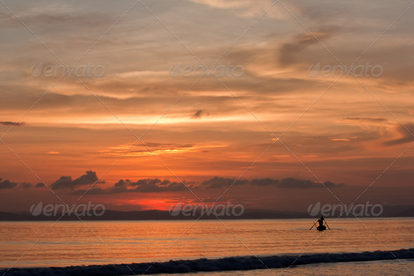 Fishing at sunset - Stock Photo - Images