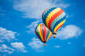 Beautiful Hot Air Balloons Against a Deep Blue Sky and Clouds. - PhotoDune Item for Sale