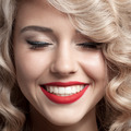 Close Up Face Of Beautiful Woman. Healthy Curly Hair. Gorgeous Smile. - PhotoDune Item for Sale