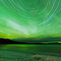 Aurora borealis startrails frozen Lake Laberge - PhotoDune Item for Sale
