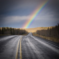 Rainbow country road dark Yukon nature landscape - PhotoDune Item for Sale