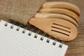 wooden spoon and notebook on old wooden table - PhotoDune Item for Sale
