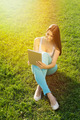 Beautiful young woman with tablet sitting on grass - PhotoDune Item for Sale