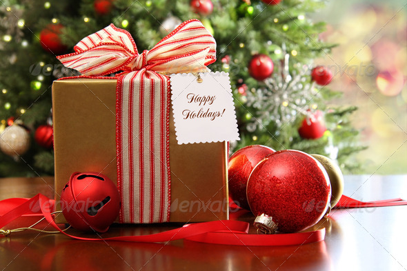 Christmas gift sitting on a table - Stock Photo - Images