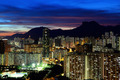 Kowloon cityscape in Kong Kong with lion rock mountain - PhotoDune Item for Sale