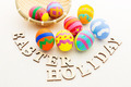 Painted easter egg in basket with wooden text - PhotoDune Item for Sale