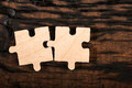 Wooden puzzle on dark background. - PhotoDune Item for Sale