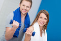Smiling attractive couple working out in a gym - PhotoDune Item for Sale