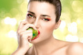 Beautiful Brunette Girl Biting an Apple - PhotoDune Item for Sale