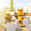 Kwak beer on the served table. Outdoors photo. - PhotoDune Item for Sale