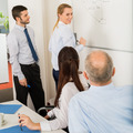 Business Team Planning Strategy On Whiteboard - PhotoDune Item for Sale