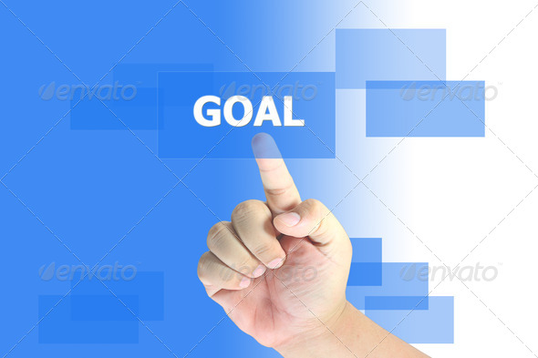 hand pushing goal button - Stock Photo - Images