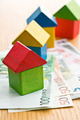 house made from wooden toy blocks with euro money - PhotoDune Item for Sale