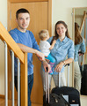 middle-aged couple with toddler with suitcases - PhotoDune Item for Sale