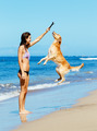 Woman Playiing with Dog Jumping into the Air - PhotoDune Item for Sale