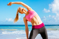 Athletic Fitness Woman Stretching At the Beach, - PhotoDune Item for Sale