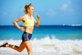 Athletic Young Woman Running on the Beach - PhotoDune Item for Sale