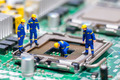 Group of construction workers repairing CPU - PhotoDune Item for Sale