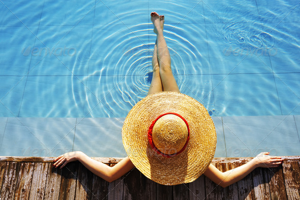Woman at poolside - Stock Photo - Images