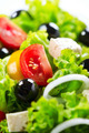 Greek Salad closeup with Feta Cheese, Tomatoes and Olives - PhotoDune Item for Sale