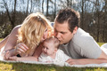 Young parents are kissing the baby - PhotoDune Item for Sale
