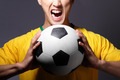 Excited sport man shouting and holding soccer - PhotoDune Item for Sale