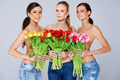 Beautiful young women with tulips - PhotoDune Item for Sale
