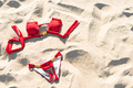 Red swimwear on sand. Holidays and vacations. - PhotoDune Item for Sale