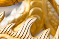 Golden sculpture close-up showing dragon spine. - PhotoDune Item for Sale