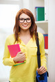 smiling female student with bag and notebooks - PhotoDune Item for Sale